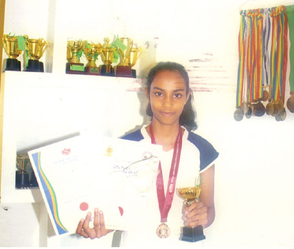 Vihangi with some of her trophies and medals. Picture by Kalutara Central Spl Corr.