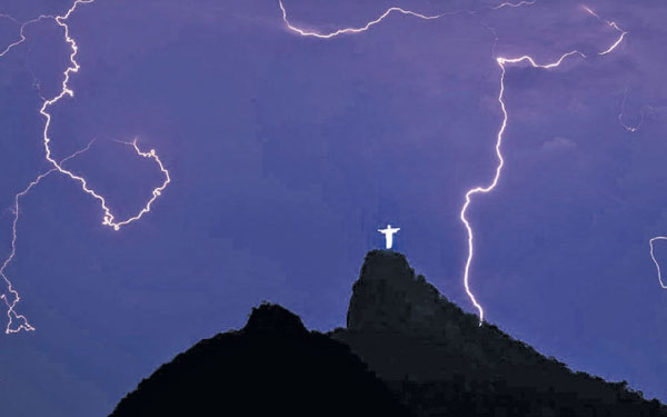 View of a lightning strike over The Christ the Redeemer Statue In Rio de Janeiro, Brazil.