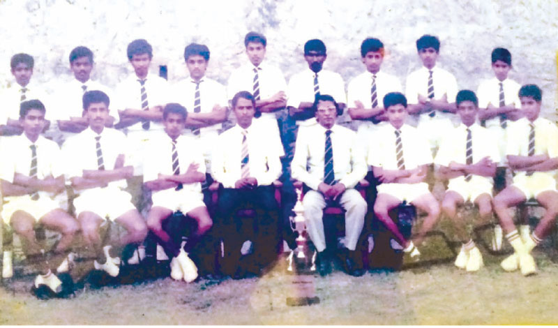 Piliyandala Central College under 15 Division Two All Island Joint Cricket Champions 1987 the Vice Captain of the Team Sriyan Chaminda  is seated third from left Seated L/R – Ranaweera D. Nishantha, Dinesh Chandrasoma, Sriyan Chaminda (Vice Captain), Nimal Wijewardene (Master In Charge and Coach), John Fernando (Principal), Tyronne Dharmasena (Captain), Malavi Arachchige Senadeera, Dinesh I. Perera Standing L/R – Neil Madanayake, Priyantha Kathriarachchi, Nirosh I Perera, Chaminda Perera, Nalin Vithanawasam