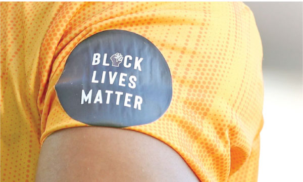 The Black Lives Matter logo, as seen seen on the shirt of Wolves' winger Adama Traoré. It will be worn by West Indies' players when they face England.