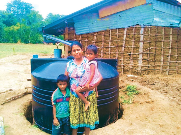 A family provided with a rain water harvesting system.