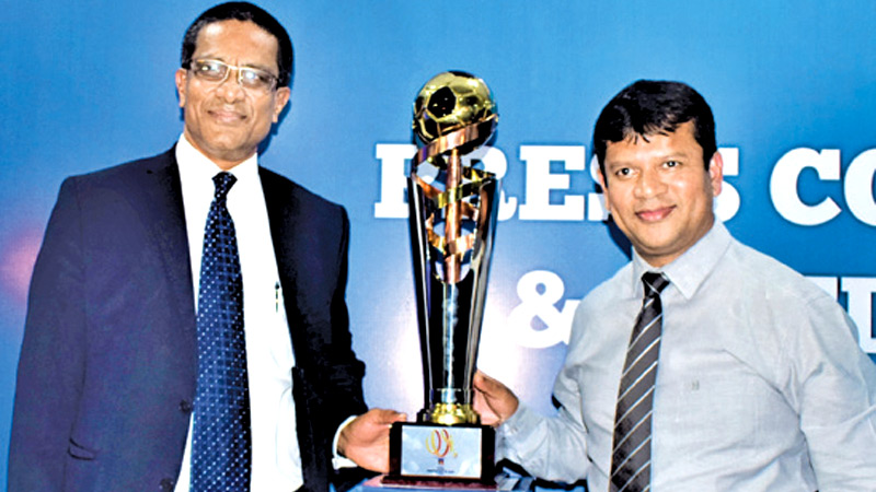 The President of FFSL Anura De Silva (left) and Jaswar Umar the General Secretary of FFSL with the FFSL President's Cup 2020.  Picture by Herbert Perera