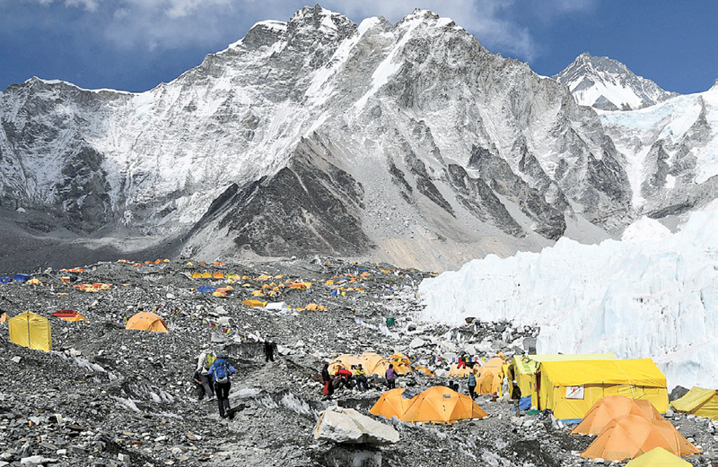 Climbers and porters are seen by their tents at Everest base camp, 140 kilometres northeast of Kathmandu. - AFP