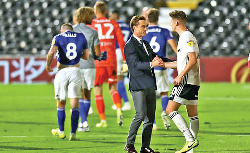 Fulham Manager Scott Parker congratulates Tom Cairney after making into the play-off final as Fulham players and staff kept celebrations to a minimum after the final whistle.