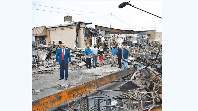 US President Donald Trump tours an area affected by recent riots in Kenosha, Wisconsin on Tuesday.