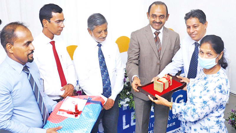 Sabry Ibrahim, CEO/GM, PLC accepts first fixed deposit of the new branch