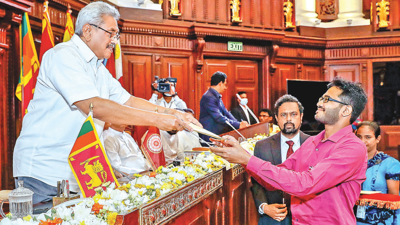 President Gotabaya Rajapaksa presenting an appointment letter to a graduate at the Presidential Secretariat on Wednesday. Pictures by President's Media Division.