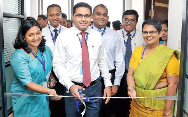 Commercial Bank's Chief Operating Officer, Sanath Manatunge declares open the Integrated Contact Centre in the presence of the Bank's Senior Manager Contact Centre Beatrice Starling, Head of Card Centre Thusitha Suraweera, Deputy General Manager Marketing Hasrath Munasinghe, Deputy General Manager Human Resource Management Isuru Tillakawardana and Deputy General Manager Personal Banking Sandra Walgama.