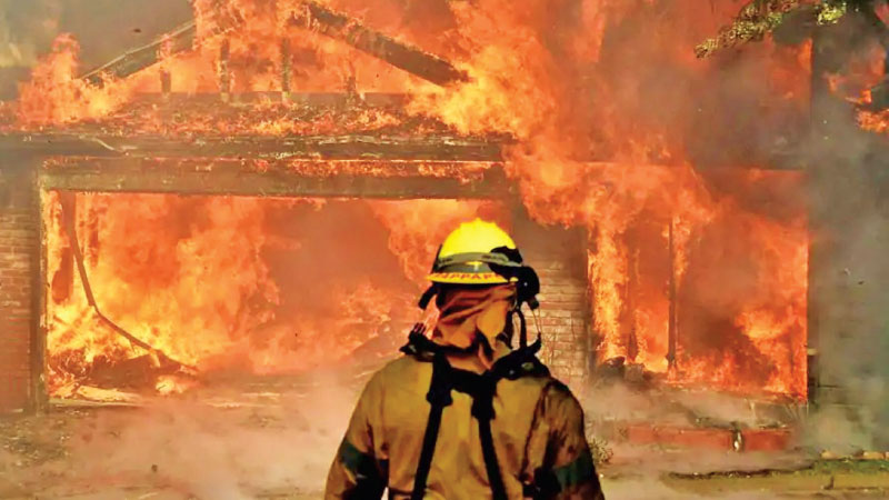 A house on fire in the Creek Fire in Fresno, California.