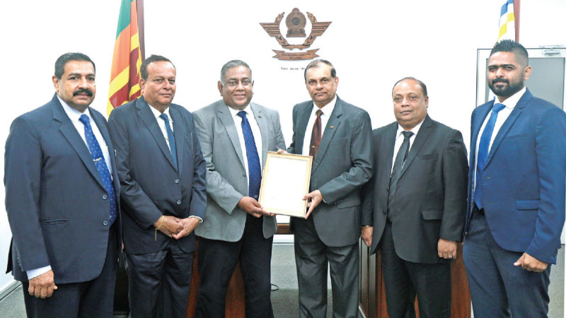 The Aviation Security Service Provider License was awarded to Major General (Rtd.) G. A. Chandrasiri (Chairman AASL) by Capt. Themiya Abeywickrama (DGCA and the Appropriate Authority for Aviation Security) at CAASL headquarters, Katunayaka looked on by other officials.