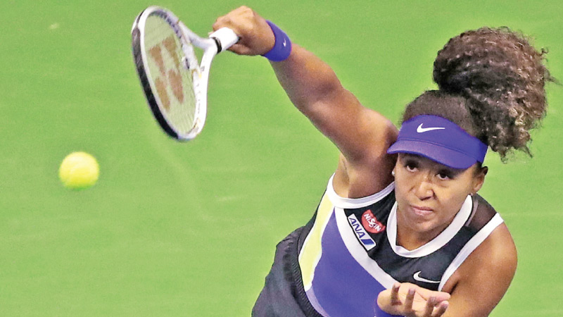 Naomi Osaka of Japan serves during her Womens Singles quarter-finals match against Shelby Rogers of the United States on Day Nine of the 2020 US Open at the USTA Billie Jean King National Tennis Center on September 8. AFP