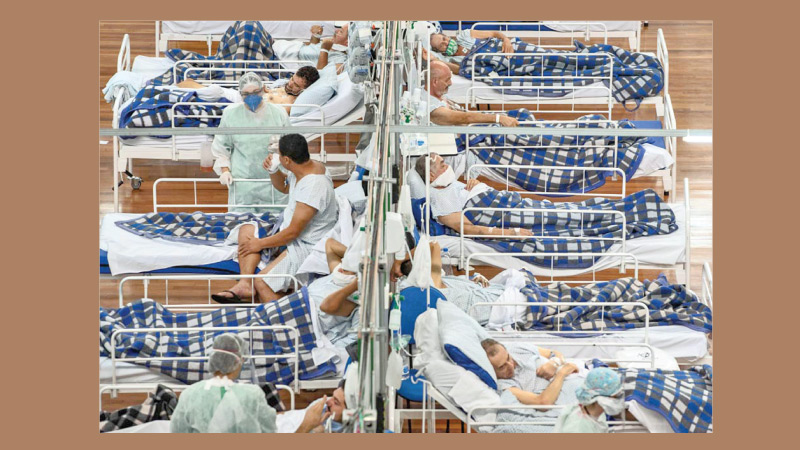 COVID-19 patients lie on beds in a field hospital built inside a gym in Santo Andre, on the outskirts of Sao Paulo, Brazil. Brazil is the worst hit country in Latin America.