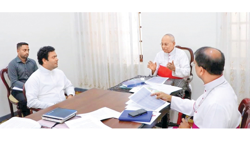 Housing and Construction and Building Material State Minister Indika Anuruddha met Archbishop Malcolm Cardinal Ranjith on September 10 and discussed the housing programme for families affected in the Easter Sunday attacks. Prime Minister and Housing and Construction Minister Mahinda Rajapaksa has instructed the State Minister to expedite the housing programme. Picture by Ashraff.A. Samad