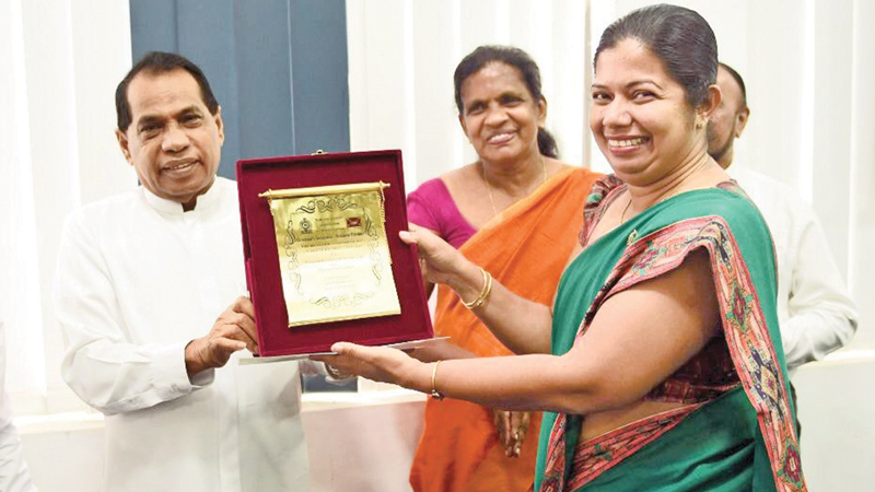 SP Governor Dr. Willie Gamage presents the Certificate of Commendation to Southern Province Governor's Secretary Dileka Kudachchi at the felicitation ceremony. Picture by Mahinda P. Liyanage, Galle Central Spl. Corr.