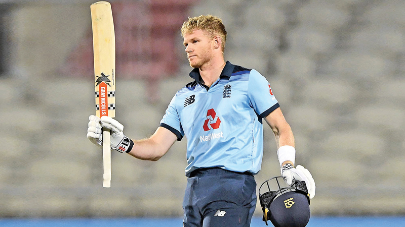 Sam Billings of England celebrates reaching his century during the 1st Royal London One Day International Series match between England and Australia at Emirates Old Trafford on September 11, 2020 in Manchester, England.