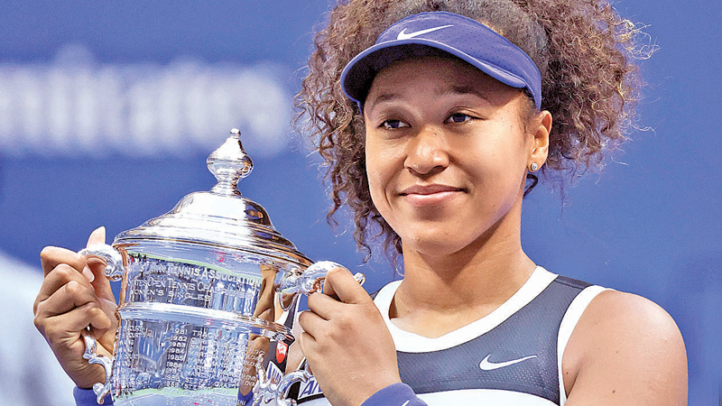 Naomi Osaka of Japan celebrates with the trophy after winning her Women's Singles final match against Victoria Azarenka of Belarus on Day Thirteen of the 2020 US Open at the USTA Billie Jean King National Tennis Center on September 12.