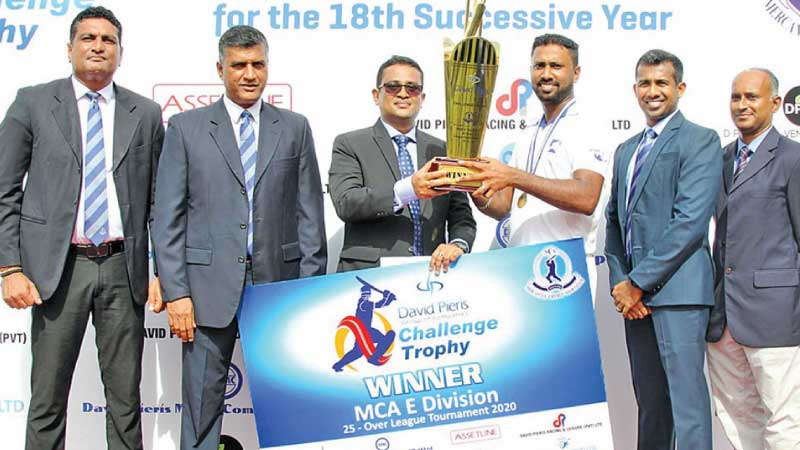 "Eagle Logistics captain, Prabuddha Ranaweera ( 3rd from right), receiving the ""DPGC"" Challenge Trophy from the chief guest, Manjula de Alwis (3 rd from left). Others in the Picture (from left) : Duminda Pinto, Rohana Dissanayake, Tarindra Kaluperuma and Ajantha Premasiri."