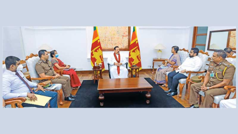 Prime Minister Mahinda Rajapaksa discussing the issue with Prison Reforms and Prisoners' Rehabilitation State Minister Sudarshani Fernandopulle and officials.
