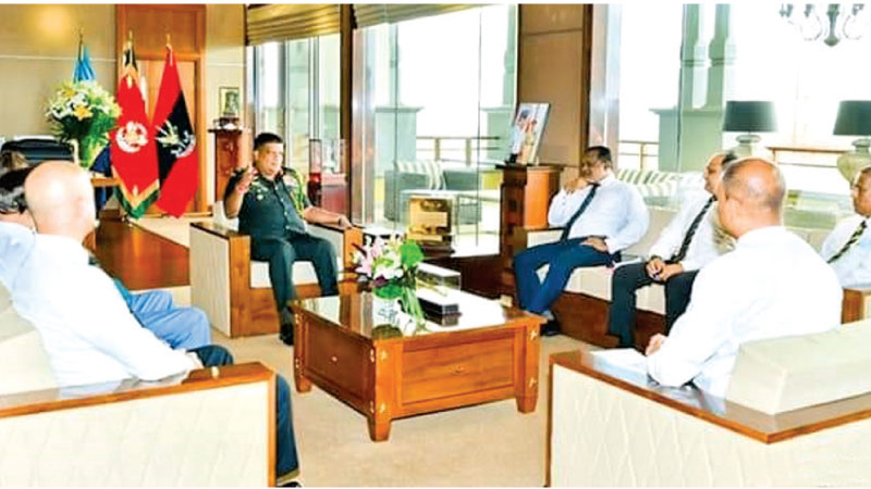 SLC officials and Shavendra Silva at a discussion.