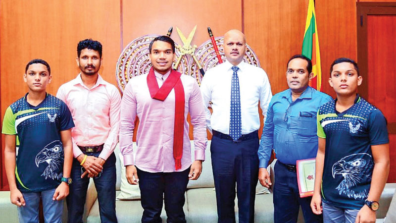 Kekirawa Ranajayapura College junior cricketers with Sports Minister Namal Rajapaksa at the Sports Ministry. The coach of the school Ajith Bandara and HR Department Head of SLC, Major Tanesh B Dias are also present.