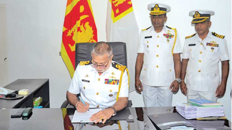 Commodore Jayantha Gamage signing the official documents.