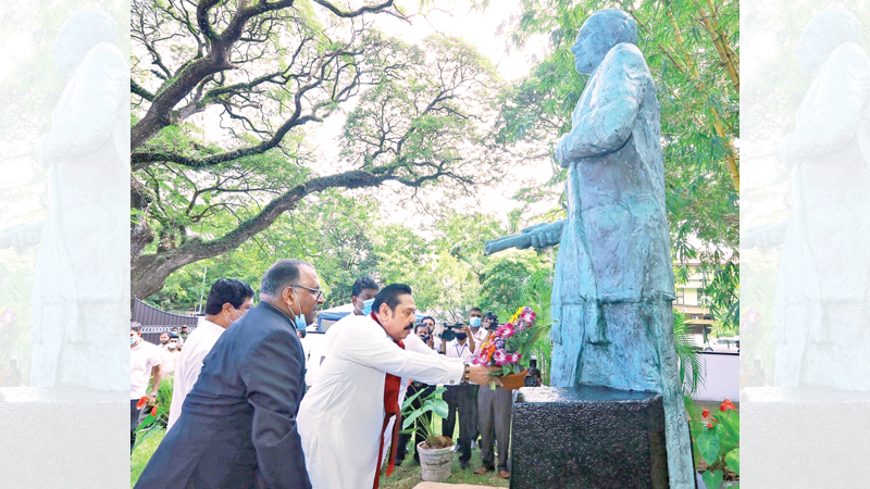 Prime Minister Mahinda Rajapaksa paying a floral tribute to mark the 37th death anniversary of late Minister Hector Kobbekaduwa at the Hector Kobbekaduwa Center in Colombo yesterday.