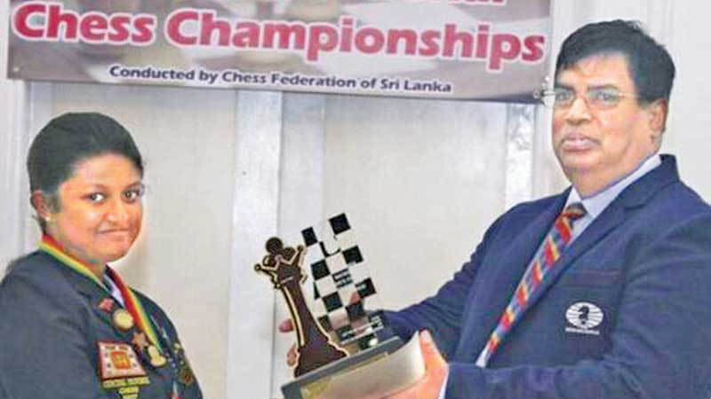 Women's National chess champion Nethmi Fernando receiving award from the CFSL President and General Secretary of South Asian Chess Council and Commonwealth Chess Assocoation Luxman Wijesuriya