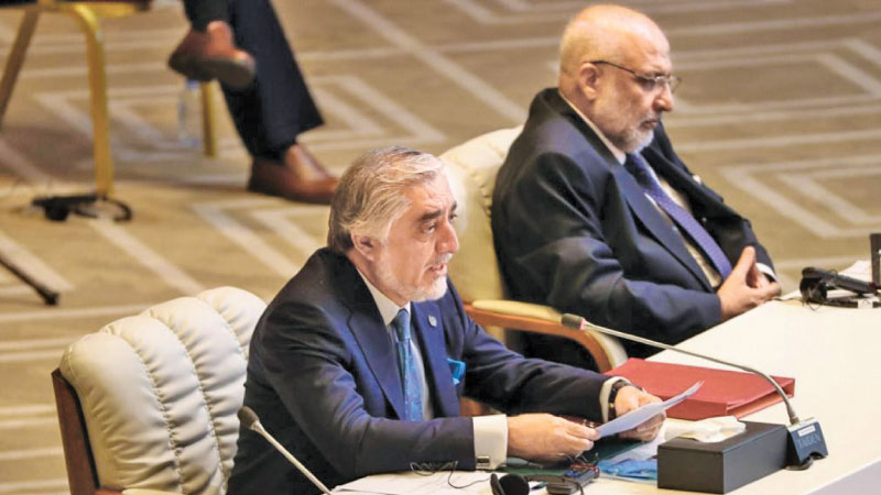Chairman of Afghanistan's High Council for National Reconciliation and lead negotiator Abdullah Abdullah (L) speaking at the historic peace talks with the Taliban in the Qatari capital Doha recently.
