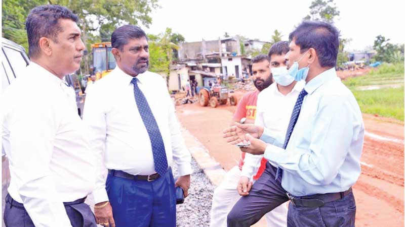 Minister Johnston Fernando with RDA officials during the inspection tour of the Udahamulla – Madiwela Road reconstruction work.