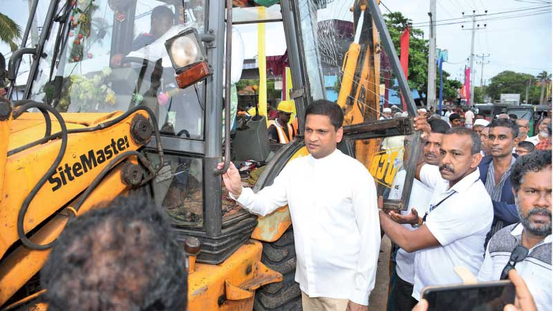 Rural Roads and Other Infrastructure State Minister Nimal Lanza inspecting a road development project in Negombo.