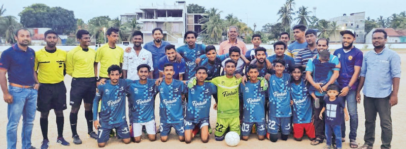 Champion Addalaichenai Zarky Youth Club football team with Youth Services Officer B.M.Riyath.