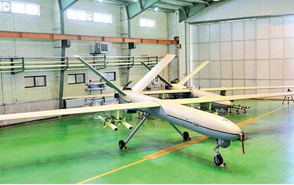 """A file picture released on September 27, 2013 by the official website of Iran's Revolutionary Guards shows a newly Iranian-made drone,  """"Shahed-129"""" (Witness 129) being shown in Tehran. Turkey and Iran are increasingly adopting  """"game-changing"""" drones as their weapon of choice against Kurdish rebels in northern Iraq, prompting fears for the safety of civilians and stoking geopolitical tensions. The Shahed-129 is one of Tehran's weapons of choice for northern Iraq, said Adam Rawnsley, who tracks Iranian dron"""