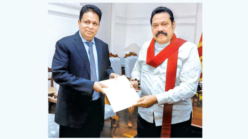 Former Sri Lankan Ambassador to Russia Dr. Saman Weerasinghe receiving his Letter of Appointment from Prime Minister Mahinda Rajapaksa at Temple Trees.