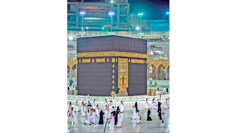 A handout picture provided by the Saudi Ministry of Hajj and Umrah on October 4, 2020, shows Saudis and foreign residents circumambulating the Kaaba (Tawaf) in the Grand Mosque complex in the holy city of Mecca, as authorities partially resume the year-round Umrah for a limited number of pilgrims amid extensive health precautions after a seven-month coronavirus hiatus. (Photo by - / Saudi Ministry of Hajj and Umra / AFP)