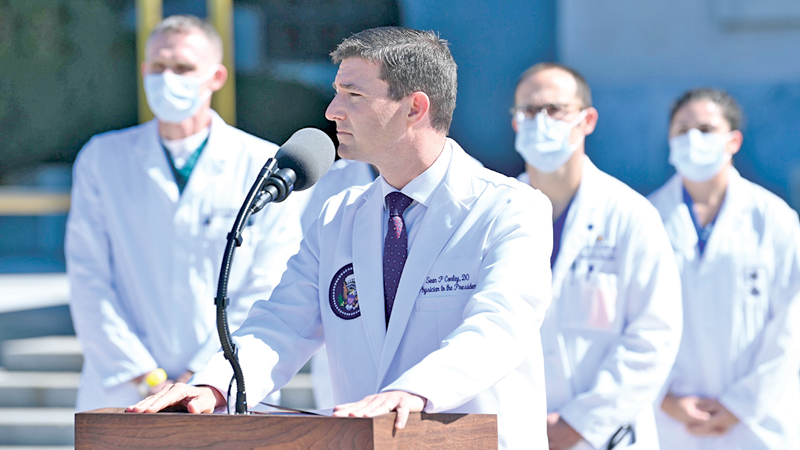 White House physician Sean Conley answers questions during an update on the condition of US President Donald Trump, on October 3, 2020, at Walter Reed Medical Center in Bethesda, Maryland. - Trump was hospitalized on October 2 due to a Covid-19 diagnosis. (Photo by Brendan SMIALOWSKI / AFP)