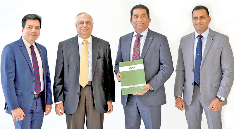 Representatives of the senior management of Commercial Bank's Bangladesh operation with the AAA rating certificate (from left) Financial Controller Binoy Gopal Roy, Senior General Manager  Dilip Das Gupta, CEO  Varuna Kolamunna and Chief Operating Officer Kapila Liyanage.