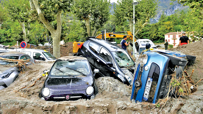 A pile of vehicles on a street in Breil-sur-Roya, south-eastern France after extensive flooding caused widespread damage in the Alpes-Maritimes department. - AFP