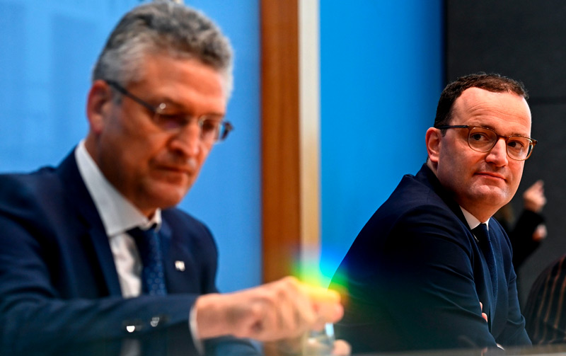 German Health Minister Jens Spahn (R) and the president of the Germany's Robert Koch Institute (RKI) Lothar Wieler (L) address a press conference amid the new coronavirus COVID-19 pandemic, on October 8, 2020 in Berlin.  New cases of coronavirus infections in Germany have soared past 4,000, official data showed October 8, 2020, reaching a daily level not seen since April 11 when the country was still in lockdown.