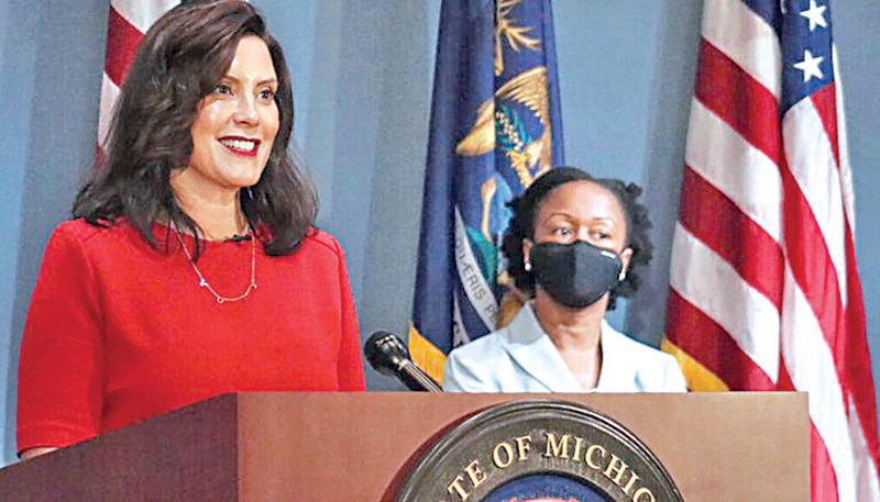 Michigan Governor Gretchen Whitmer (L) addressing a recent press conference.