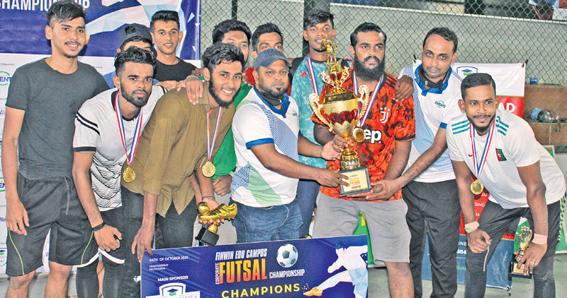 Captain of the winning team Astech Bath Touch Private Limited Abdul Raqeeb receiving the champion award and cash prize from Finwin Group Chairman Faroon Hamim. Group Director Thaha Magbool and members of the team were also present.  Picture by Ruzaik Farook