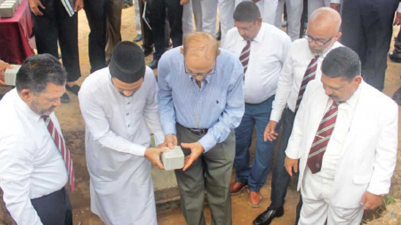Firoze Limited Chairman and Phoenix Ventures Limited  Director Mohamed Haji Omar laying the Foundation Stone. Principal Trizviy Marikkar, Chairman of the Board of Governors Fouzul Hameed, Old Boys Association president Naina Mohamed, Project Chairman Jisthy Fahmi  and Ash Sheik Arkam Nooramith are also present. Picture by Ruzaik Farook