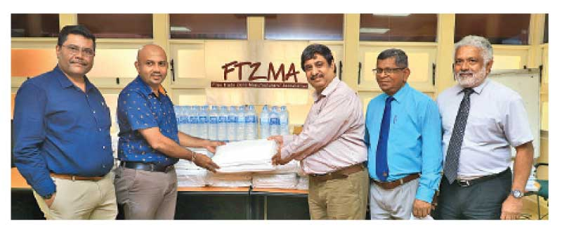 The donation made by the Chairman, Jitendra Biala and Secretary, Dhammika Fernando at their secretariat to Dr Aruna Plaitha Sampath – Director/E&OH Gampaha Division with the patronage of Director-KEPZ of BOI Sisil Fernando.