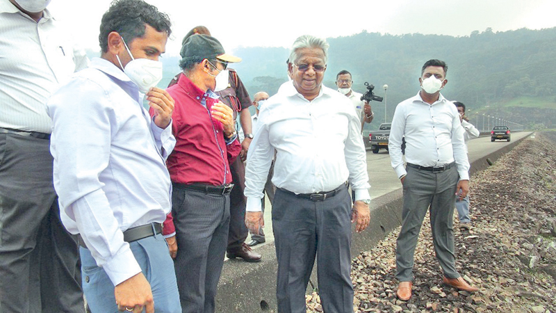 State Minister Siripala Gamlath along with officials inspecting the reservoir.
