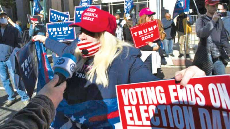 Pro-Donald Trump supporters campaign for their candidate in Pittsburgh, Pennsylvania.