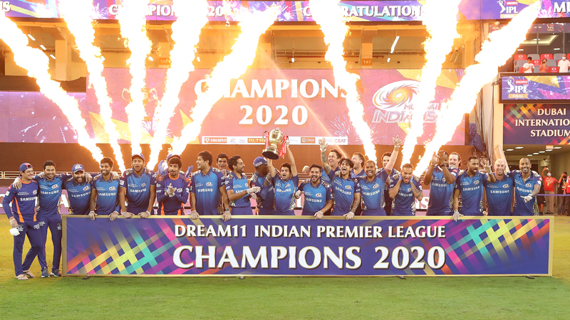 Mumbai Indians team celebrate with the IPL trophy