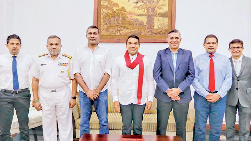 The Sri Lanka Rugby (SLR) officials met Sports Minister Namal Rajapaksa, on Monday to discuss the future endeavours of their association. SLR officials pose for a picture with the minister. (From left to Right) Treasurer SLR Dinesh Perera, Vice President, SLR Rear Admiral H.A.U.D. Hettiarachchi, Deputy President SLR Nazeem Mohamed, Sports Minister Namal Rajapaksa, President SLR Rizly illyas, Secretary SLR Jude Pillai, Consultant SLR Kevin Herft.