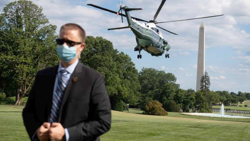 A US Secret Service agent stands by as Marine One, with US President Donald Trump aboard, departs from the South Lawn of the White House in Washington, DC, recently.