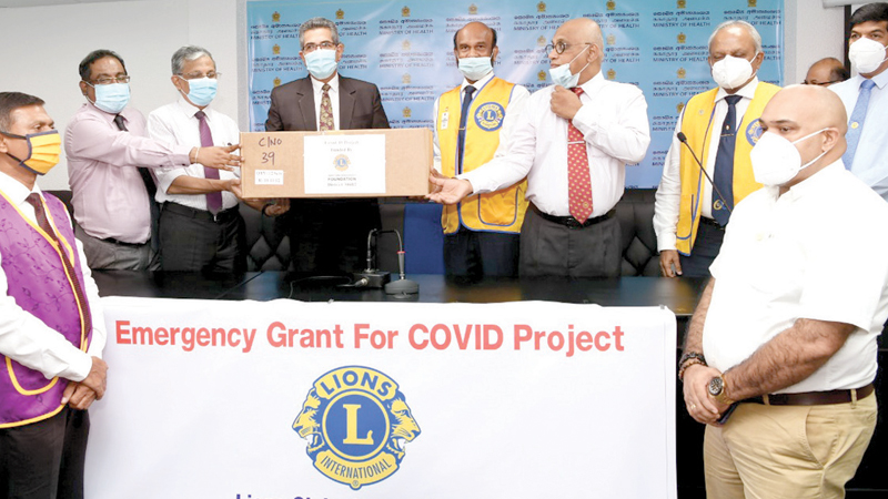 District 306 B 2 Lions Club members making the donation.