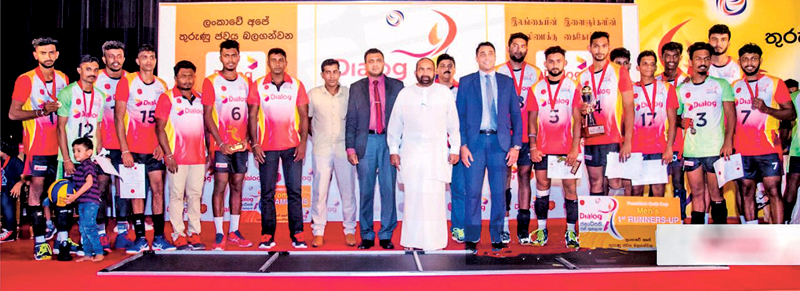 Rantharu Sports Club were the Runners Up of President's Gold Cup Volleyball Tournament in 2019 and after the game they posed for a photograph with the President of the Volleyball Federation of Sri Lanka Ranjith Siyambalapitiya. Ruchira Sampath is standing in the back row first from left. (Picture by Dilwin Mendis – Moratuwa Sports Special Correspondent)