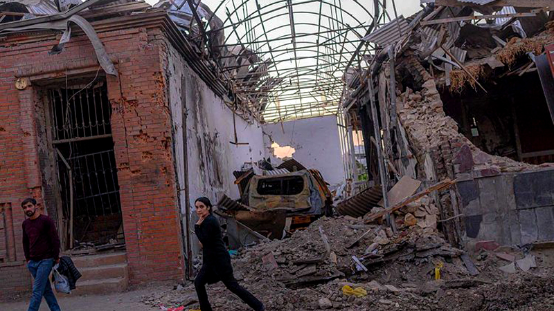 Local residents walk in a street after it was hit by a missile in Gandja in Azerbaijan in this October 8, 2020 file photo. Azerbaijan has emerged victorious in the war.